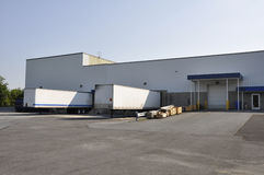 Two trucks at unloading dock stock photography