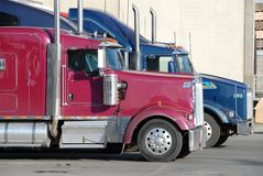 Two trucks at warehouse. Two semi trucks at warehouse waiting to be loaded Royalty Free Stock Image