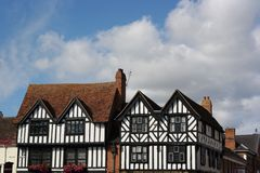 Two tudor buildings. Detail of two tudor timber framed buildings stratford-on-avon England black and white fronted blue cloudy sky daytime Stock Images