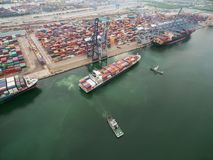 Two tug boat towing cargo container in warehouse harbor at thail. Two tug boat towing cargo container in warehouse harbor at thai Stock Photo