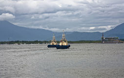 Two tug boats coming into Cairns Port Royalty Free Stock Photography
