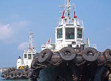 Two Tugboat with Large Tires Stock Photos