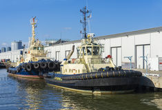Two tugboats berthing in a dock Stock Image