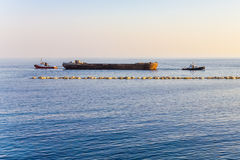Two Tugboats Hauling A Barge . Royalty Free Stock Images