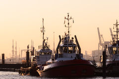 Two tugboats moored in a harbour Royalty Free Stock Photos