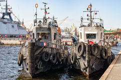 Two tugboats moored at the Lieutenant Schmidt embankment. Royalty Free Stock Photography