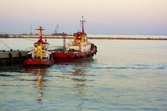 Two tugboats near the pier. Seaview landscape Royalty Free Stock Photos