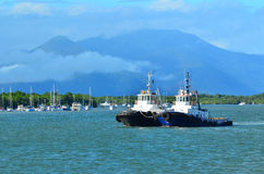 Two tugboats sail  at the entrance to Trinity Inlet in Queenslan Royalty Free Stock Photography