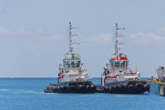 Two Tugboats Tied up at Pier Stock Photos