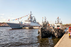 Two tugboats and a warship moored at the Lieutenant Schmidt embankment. Royalty Free Stock Image