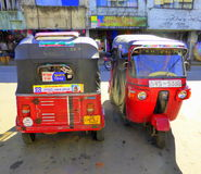 Two parked tuk tuks Stock Images