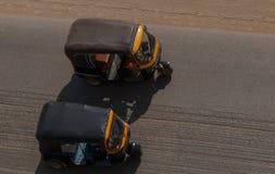 Two tuk-tuks on street of Cairo. Egypt Stock Photos