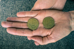 Two Tunisian coins on the woman's palm.  Stock Images