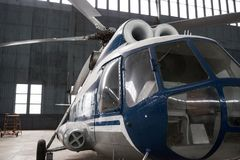 Two-turbine helicopter Mi-8 in the hangar. stock photo
