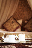 Two turkish coffee cups with oriental canopy bed at the backgrou Royalty Free Stock Photos