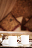 Two turkish coffee cups with oriental canopy bed at the backgrou Stock Image
