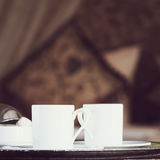 Two turkish coffee cups with oriental canopy bed at the backgrou Royalty Free Stock Image