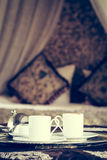 Two turkish coffee cups with oriental canopy bed at the backgrou Stock Photos