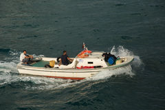Two Turkish men on a motor boat in the strait of Bosporus Stock Images