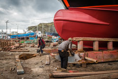 Two turkish men working near new ship Stock Photo