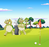 Two turtles playing golf Royalty Free Stock Photos