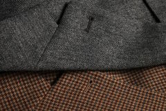 Two tweed coat lapels side-by-side. A gray and a brown classic woolen tweet coats side-by-side. Lapels detail Stock Photography