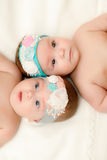 Two twin babies, girls in nice headbands Royalty Free Stock Photo