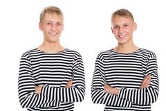 Two twin brother vests with arms crossed Stock Images
