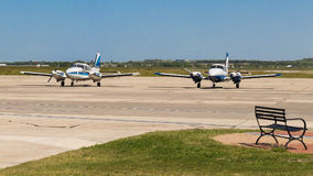 Two twin engine planes at an airfield. Two twin engine planes parked Royalty Free Stock Images