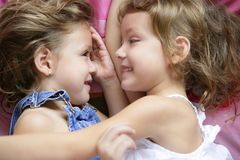 Two twin sisters in a hug, close up Royalty Free Stock Images