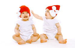 Two twins baby. In hats Royalty Free Stock Photos