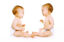 Two twins baby. On a white background Royalty Free Stock Images