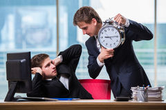 The two twins businessmen arguing with each other over deadline Stock Photo