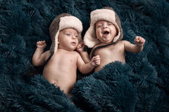 Two twins laying on the soft fluffy blanket Stock Photography