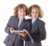 Two twins with textbook Royalty Free Stock Photos