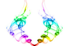 Two twirls of smoke with bright rainbow colors stock photography