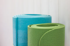 Two twisted yoga mats Stock Image