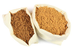 Two types brown sugar in white fabric bags. Royalty Free Stock Photos