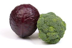Two types of cabbage: scotch kale and broccoli. Fresh colourful types of cabbage: red scotch kale and green broccoli on the  white background Stock Photography