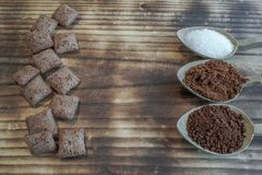Two types of cafe sugar and cakes royalty free stock images