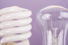 Two types of light bulbs on blue background Royalty Free Stock Photos