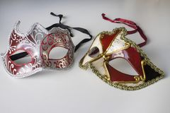 Typical colored venetian masks. Two typical colored venetian masks stock image
