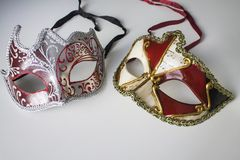 Typical colored venetian masks. Two typical colored venetian masks stock photos