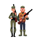 Two typical hunters, male and female, standing with rifles Stock Image