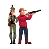 Two typical hunters, male and female, standing with rifles Royalty Free Stock Image