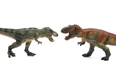 Two tyrannosaurus toys on white background Royalty Free Stock Images