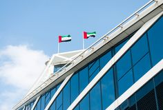 Two UAE flags on modern building. Royalty Free Stock Photo