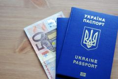Two Ukrainian biometric passports with fifty euros banknote. stock photography