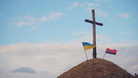 Two Ukrainian flags. Two Ukrainian flag on grave stock video