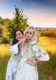 Two ukrainian girls in national costumes at the meadow Royalty Free Stock Photo